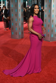 Angela Bassett looked simply elegant at the BAFTAs in a sleeveless fuchsia fishtail gown.