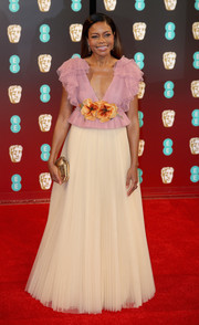 Naomie Harris oozed girly appeal in a flower-appliqued two-tone ruffle gown by Gucci at the 2017 BAFTAs.