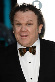 John C. Reilly showed off his unique style with a feathered bow tie at the BAFTAs.