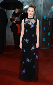 Saoirse Ronan looked sweet in her black Christopher Kane dress with blue and purple appliqued flowers. Her hair matched the mood of the design with a youthful messy updo.