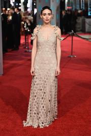Rooney Mara worked the BAFTAs red carpet in a nude cold-shoulder gown by Givenchy, rendered entirely in geometric cutouts.