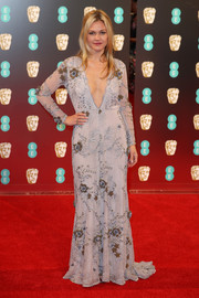 Julia Stiles took a sexy plunge with this deep-V, floral-embroidered gown by Maria Korovilas at the 2017 BAFTAs.