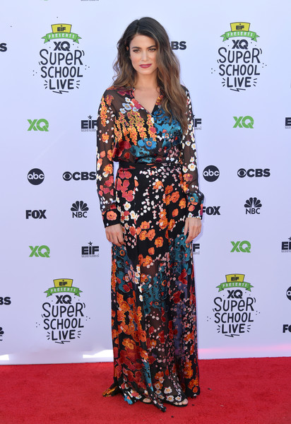 Nikki Reed made a stylish appearance at the XQ Super School Live in a colorful floral maxi dress.