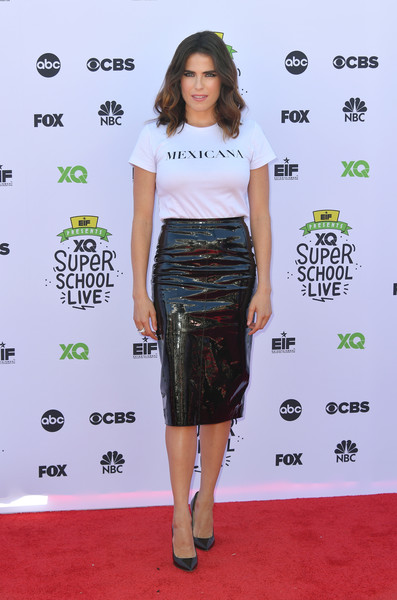 Karla Souza punched up her casual top with a shiny black pencil skirt.
