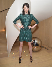Coco Rocha amped up the glitz in a beaded emerald mini dress by Elie Saab during Rihanna's party.