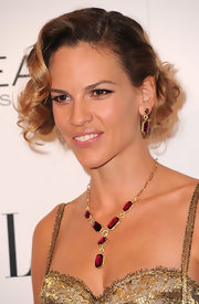 Hilary Swank was the perfect picture of elegance in her ruby Chatelaine earrings.
