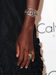 Viola spiced up her ensemble with a little arm candy. A sparkling cuff bracelet completed her elegant look.
