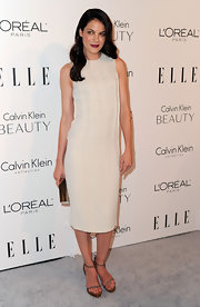Michelle goes for a modernist look in this chic cream cocktail dress with a simple silhouette and textured bodice.