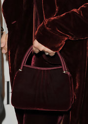 Barbra Streisand was in the mood for burgundy velvet when she attended the Women in Hollywood Tribute, complementing her pantsuit with this evening bag.