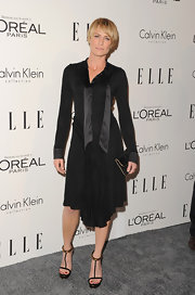 Robin Wright stepped out at the Women in Hollywood Tribute in a black knit cocktail dress with a long ascot necktie.