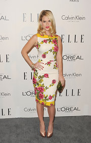 Alice Eve added glitter to her feminine floral pencil dress with a glittery green hard case clutch.