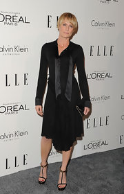 Robin Wright Penn paired her all-black ensemble with black strappy heels with gold ankle cuff detailing.