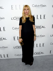 Rachel Zoe stuck to her trademark look with this black Calvin Klein maxi dress at the Elle Women in Hollywood celebration.