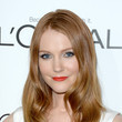 Darby Stanchfield's soft waves and candy apple red lips