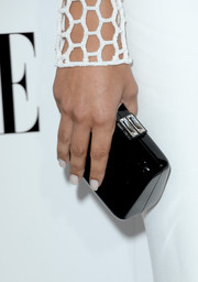 Naya Rivera accessorized with a tiny black hard-case clutch by Jimmy Choo during the Elle Women in Hollywood celebration.