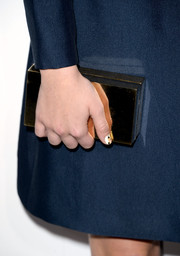 Zoey Deutch added some shine to her ensemble with a gold box clutch when she attended the Elle Women in Hollywood celebration.