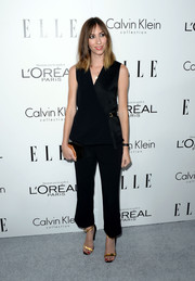 Gia Coppola opted for Calvin Klein separates, consisting of ankle-length black slacks and a wrap top, when she attended the Elle Women in Hollywood celebration.