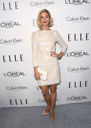 Caitlin Fitzgerald exuded a '20s-chic vibe in a patterned white shift dress during the Elle Women in Hollywood celebration.