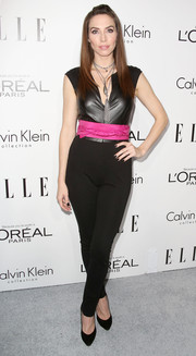 Whitney Cummings looked foxy in a tight-fitting black jumpsuit, cinched at the waist with a fuchsia sash, during the Elle Women in Hollywood celebration.