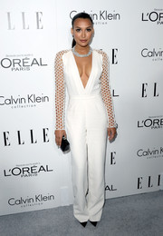 Naya Rivera blew us away with this fierce white Pamella Roland jumpsuit featuring a navel-grazing neckline and mesh sleeves during the Elle Women in Hollywood celebration.