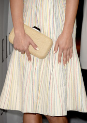 Lea Michele carried a patterned nude hard-case clutch by Kotur when she attended the Elle Women in Hollywood celebration.
