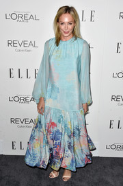 Lubov Azria chose a long-sleeve turquoise maxi dress with a paint splatter-print skirt for the Elle Women in Hollywood event.
