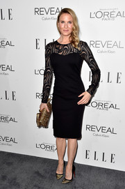 Renee Zellweger paired her dress with a chic pair of gold and black evening pumps by Christian Louboutin.