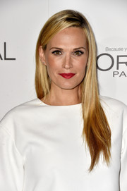 Molly Sims punctuated her look with a bold red lip.