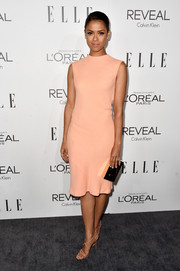 A gold box clutch completed Gugu Mbatha-Raw's minimalist-chic ensemble.