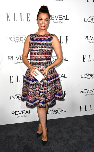A simple white Rauwolf box clutch rounded out Bellamy Young's ensemble.