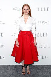 Jessica Chastain's red vinyl skirt (also by Calvin Klein) kept the look from getting too office-y.