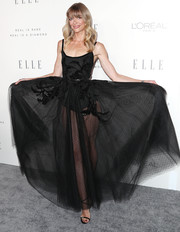 Jaime King sealed off her head-turning attire with strappy black heels by Giuseppe Zanotti.