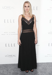 Jennifer Lawrence looked alluring in a black lace-panel slip gown by Dior during Elle's Women in Hollywood celebration.