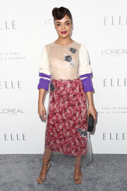 Tessa Thompson completed her striking ensemble with a printed red pencil skirt, also by Calvin Klein.
