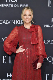 Molly Sims matched a metallic red clutch with a sequined dress for the 2018 Elle Women in Hollywood celebration.