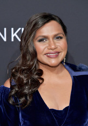 Mindy Kaling swiped on some blue eyeshadow to match her dress.