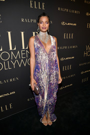 Indya Moore worked a shimmering lavender gown with a plunging neckline at the 2019 Elle Women in Hollywood celebration.