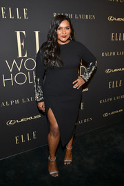 Mindy Kaling cut an elegant figure in an Oscar de la Renta LBD with crystal-embellished sleeves at the 2019 Elle Women in Hollywood celebration.