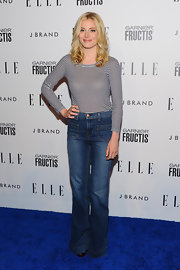 "Gillian opted for a 70's look on the red carpet in a pair of ""Bette"" high-rise wide leg jeans."