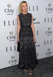 Kirsten Dunst paired her lovely dress with pleated black satin sandals by Olgana Paris.