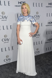 Jenna Elfman was demure and stylish at the Elle Women in Television dinner in a flowing white Tadashi Shoji  dress with a floral-embroidered yoke.