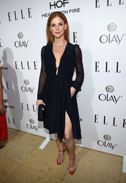 Sarah Rafferty arrived at ELLE's Annual Women in Television Celebration in a gorgeous navy dress with mesh sleeves and a deep plunge.