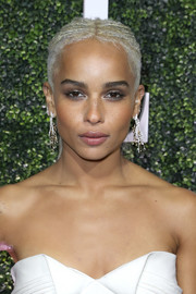 Zoe Kravitz teamed her 'do with edgy-glam chandelier earrings by Swati Dhanak.