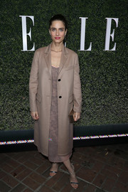 Amanda Peet arrived for Elle's Women in Television celebration wearing a beige wool coat over a matching dress.