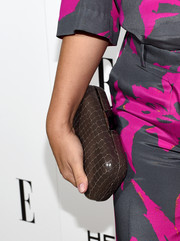 Busy Philipps picked a plain brown clutch to go with her bold outfit.