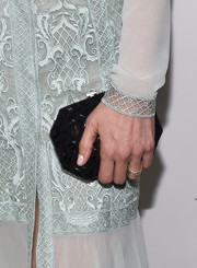 Jenna Elfman's clutch by Ferragamo was a great contrast to her pastel dress.