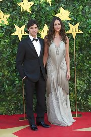 Eva Gonzales arrived at the ELLE Awards wearing a long dress with fringe.