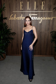 Zoey Deutch looked simply elegant in a navy slip gown at the Elle & Ferragamo Hollywood Rising celebration.