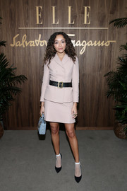 Ashley Madekwe went business-chic in a blush skirt suit by Dior at the Elle & Ferragamo Hollywood Rising celebration.