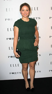 Erika dons a ruched green cocktail dress for the Elle dinner party.